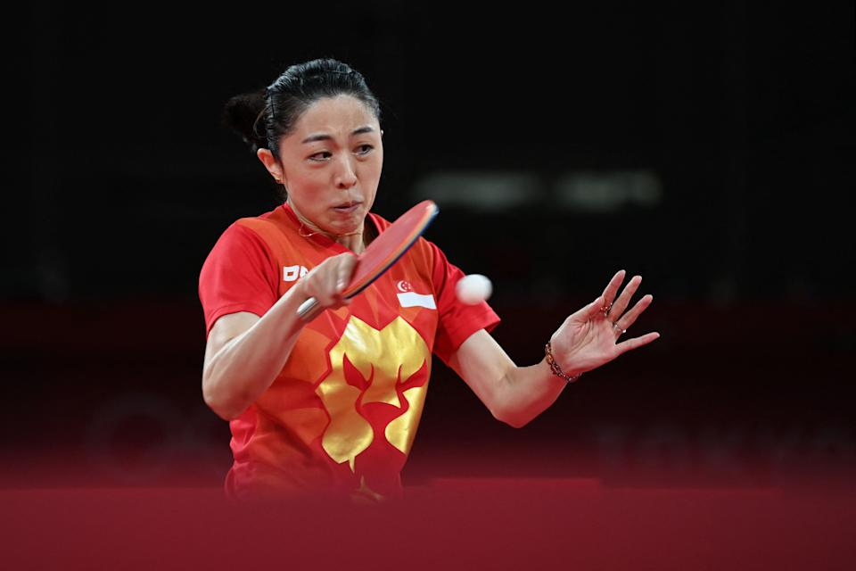 Singapore paddler Yu Mengyu competes against China's Chen Meng during their women's singles semi-finals table tennis match during the 2020 Tokyo Olympics.