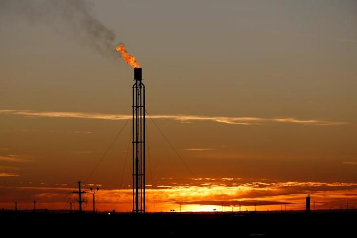 FILE PHOTO: A flare burns excess natural gas in the Permian Basin in Loving County, Texas