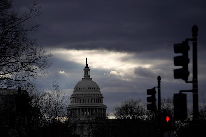 <p>Clouds pass over the U.S. Capitol on 17 January 2021 in Washington, DC. After last week's riots at the U.S. Capitol Building, the FBI has warned of additional threats in the nation's capital and in all 50 states.</p> (Getty Images)