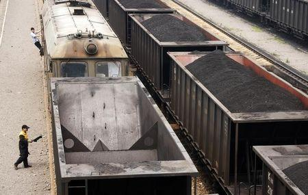 Freight trains are seen loaded with coal at a coal mine company in Huaibei