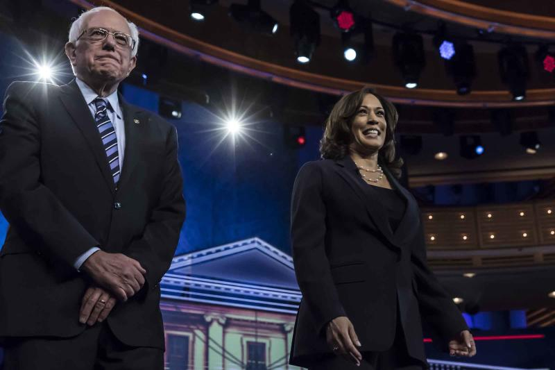 Democratic presidential hopefuls (fromL) US Senator for Vermont Bernie Sanders and US Senator for California Kamala Harris participate in the second Democratic primary debate of the 2020 presidential campaign season hosted by NBC News at the Adrienne Arsht Center for the Performing Arts in Miami, Florida, June 27, 2019. | Christopher Morris for TIME