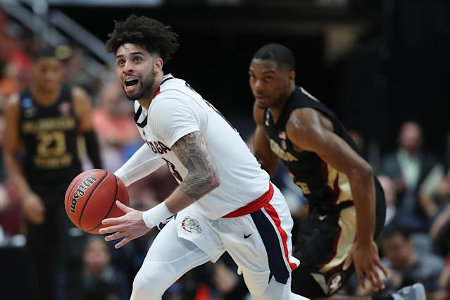 <p>Josh Perkins #13 of the Gonzaga Bulldogs controls the ball against the Florida State Seminoles during the 2019 NCAA Men's Basketball Tournament West Regional at Honda Center on March 28, 2019 in Anaheim, California. (Photo by Sean M. Haffey/Getty Images) </p>