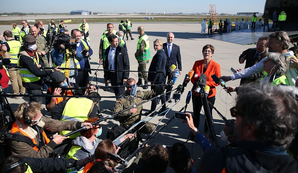 German Defence Minister Annegret Kramp-Karrenbauer speaks to the media during a delivery of protective masks from China on April 27, 2020 at the airport of Leipzig, eastern Germany. (Photo by Ronny Hartmann / AFP) (Photo by RONNY HARTMANN/AFP via Getty Images)