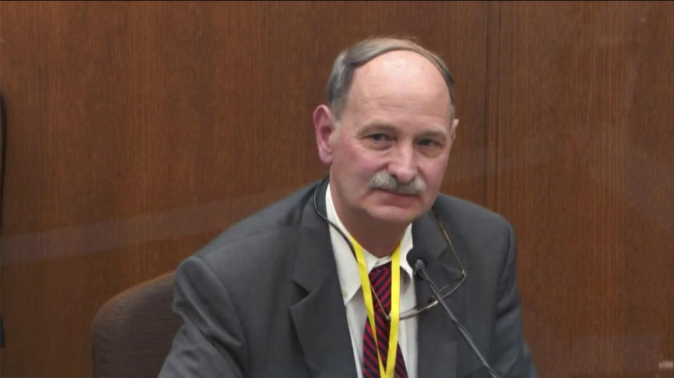 In this image taken from video witness Dr. Bill Smock, a Louisville physician in forensic medicine testifies as Hennepin County Judge Peter Cahill presides Thursday, April 8, 2021, in the trial of former Minneapolis police Officer Derek Chauvin at the Hennepin County Courthouse in Minneapolis, Minn. Chauvin is charged in the May 25, 2020 death of George Floyd. (Court TV via AP, Pool)