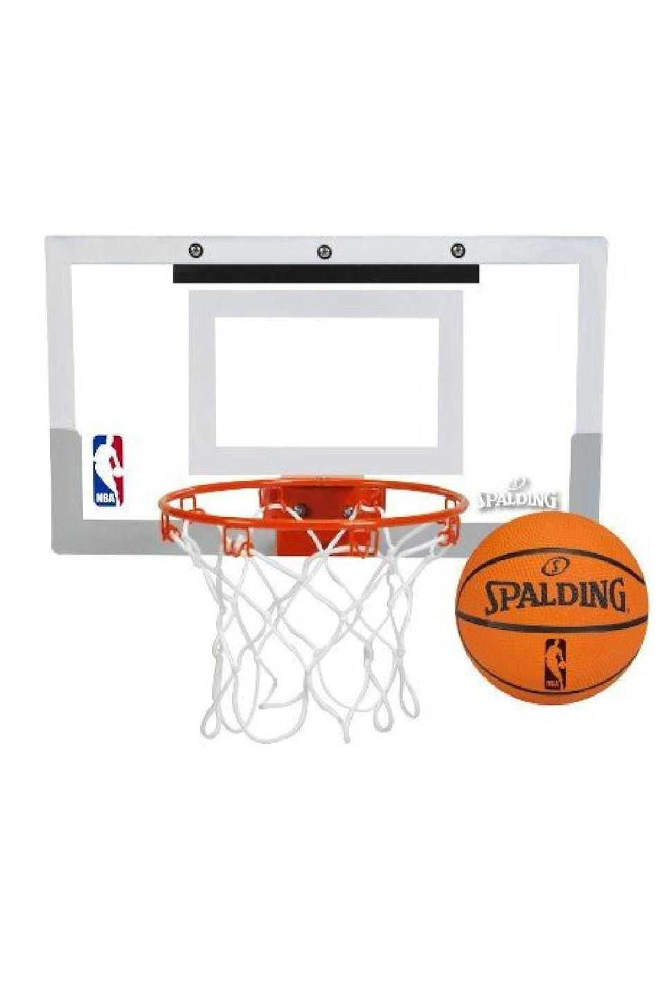 """<p><strong>Spalding</strong></p><p>amazon.com</p><p><strong>$27.99</strong></p><p><a href=""""https://www.amazon.com/dp/B0085AOZIK?tag=syn-yahoo-20&ascsubtag=%5Bartid%7C10049.g.5199%5Bsrc%7Cyahoo-us"""" rel=""""nofollow noopener"""" target=""""_blank"""" data-ylk=""""slk:Shop Now"""" class=""""link rapid-noclick-resp"""">Shop Now</a></p><p>A mini basketball hoop (that also comes with a ball!) is a great not-too-serious gift, and it's perfect if he enjoys nothing more than watching players dunk on each other.</p>"""
