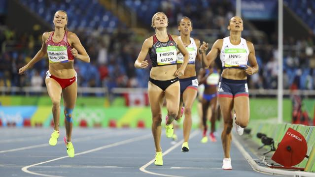 2016 Rio Olympics - Athletics - Women's Heptathlon 800m - Olympic Stadium - Rio de Janeiro, Brazil - 13/08/2016. Jessica Ennis-Hill (GBR) of Great Britain (R), Brianne Theisen-Eaton (CAN) of Canada (C) and Laura Ikauniece-Admidina (LAT) of Latvia (L) compete. REUTERS/Lucy Nicholson FOR EDITORIAL USE ONLY. NOT FOR SALE FOR MARKETING OR ADVERTISING CAMPAIGNS.