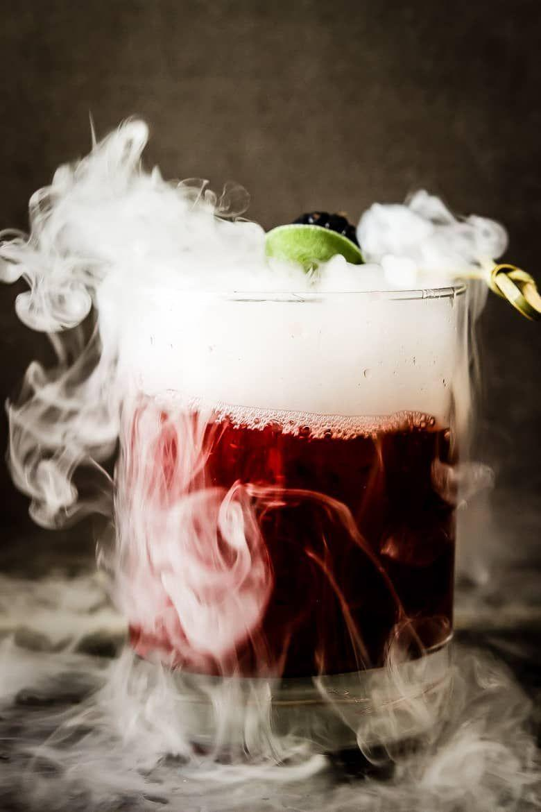 """<p>Give your drink a spell-binding, smoky effect from both burning sage and dry ice. It's a fun concoction for any Halloween party!</p><p><strong>Get the recipe at <a href=""""https://www.wickedspatula.com/blackberry-sage-margarita/"""" rel=""""nofollow noopener"""" target=""""_blank"""" data-ylk=""""slk:Wicked Spatula"""" class=""""link rapid-noclick-resp"""">Wicked Spatula</a>. </strong></p><p><a class=""""link rapid-noclick-resp"""" href=""""https://go.redirectingat.com?id=74968X1596630&url=https%3A%2F%2Fwww.walmart.com%2Fsearch%2F%3Fquery%3Dcocktail%2Bglasses&sref=https%3A%2F%2Fwww.thepioneerwoman.com%2Fholidays-celebrations%2Fg36982659%2Fhalloween-drink-recipes%2F"""" rel=""""nofollow noopener"""" target=""""_blank"""" data-ylk=""""slk:SHOP COCKTAIL GLASSES"""">SHOP COCKTAIL GLASSES</a></p>"""