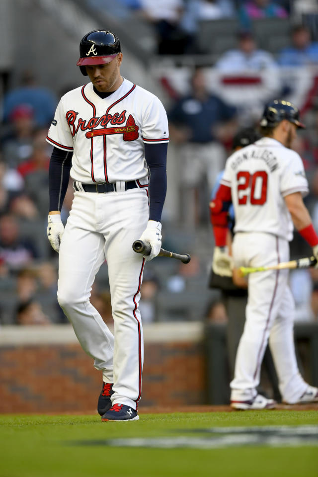 Atlanta Braves' Freddie Freeman strikes out in the fourth inning of Game 5 of their National League Division Series baseball game against the St. Louis Cardinals, Wednesday, Oct. 9, 2019, in Atlanta. (AP Photo/John Amis)