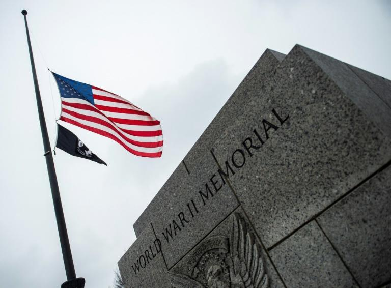 The US flag flies at half-staff at the World War II Memorial in Washington in tribute to former US president George H.W. Bush