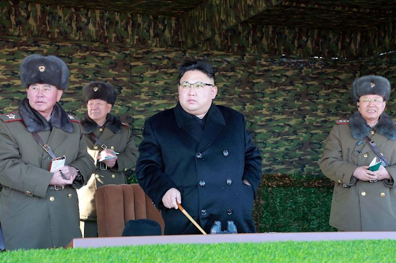 North Korean leader Kim Jong-Un (C) inspects a tactical military drill at an undisclosed location