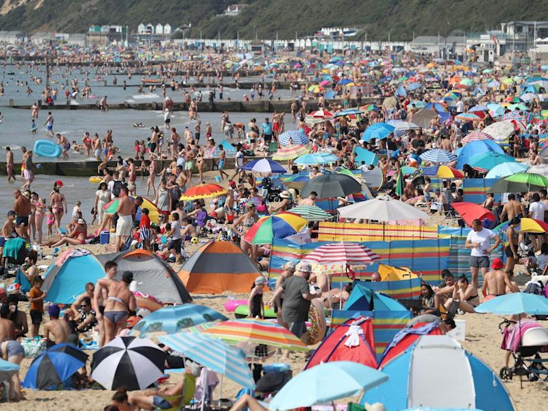 Throngs of people crowd Bournemouth beach in Dorset for third day in a row as heatwave continues: PA