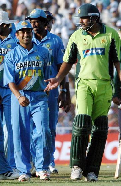 AHMEDABAD, INDIA:  Pakistani cricket captain Inzamam-ul-Haq (R) gestures as he speaks with Indian cricketer Sachin Tendulkar (2L) after his team's victory at the one day international match between India and Pakistan at the Sardar Patel Cricket Stadium in Ahmedabad, 12 April 2005.  Pakistan defeated India by three wickets off the last ball to level the six-match series 2-2.                 AFP  PHOTO/RAVEENDRAN  (Photo credit should read RAVEENDRAN/AFP/Getty Images)
