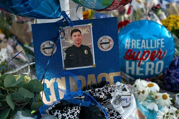 PHOTO: A photo of slain Police Officer Jonathan Shoop is displayed at a memorial outside the Bothell Police Department on July 14, 2020 in Bothell, Wa. Shoop was shot and killed after a pursuit following a traffic stop on July 13, 2020. (David Ryder/Getty Images)