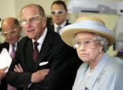 <p>The Duke of Edinburgh and Queen Elizabeth II wear safety glasses during a laser surgery demonstration at the University College Hospital, London, during a tour of the new facility which was officially opened by the Queen. (Photo credit: PA/PA Archive/PA Images) </p>