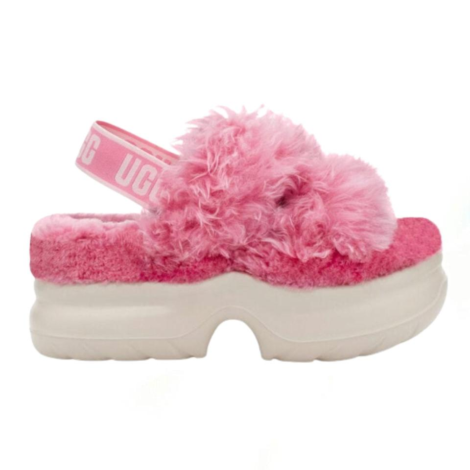 """If you were one of the many who saw the Ugg Fluff Yeah slipper as <a href=""""https://www.glamour.com/story/best-uggs?mbid=synd_yahoo_rss"""" rel=""""nofollow noopener"""" target=""""_blank"""" data-ylk=""""slk:your own personal lockdown hero"""" class=""""link rapid-noclick-resp"""">your own personal lockdown hero</a>, you'll love this updated version that's great for going out (though technically you can wear the original style outdoors). The pastel fluff might look like the equivalent of Peeps on your feet, but they're also made sustainably with a fiber sourced from responsibly harvested trees. $120, Ugg. <a href=""""https://www.ugg.com/womens-slippers/fluff-sugar-platform/1117325.html"""" rel=""""nofollow noopener"""" target=""""_blank"""" data-ylk=""""slk:Get it now!"""" class=""""link rapid-noclick-resp"""">Get it now!</a>"""