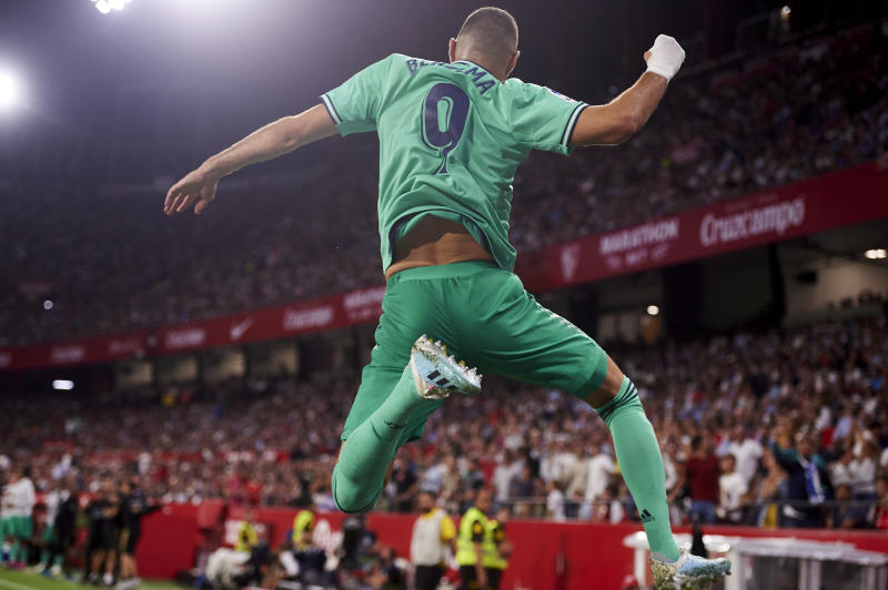 SEVILLE, SPAIN - SEPTEMBER 22: Karim Benzema of Real Madrid CF celebrates after scoring a goal during the Liga match between Sevilla FC and Real Madrid CF at Estadio Ramon Sanchez Pizjuan on September 22, 2019 in Seville, Spain. (Photo by Aitor Alcalde/Getty Images)