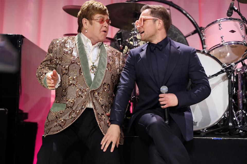 WEST HOLLYWOOD, CA – FEBRUARY 24: Sir Elton John and Taron Egerton perform onstage during the 27th annual Elton John AIDS Foundation Academy Awards Viewing Party sponsored by IMDb and Neuro Drinks celebrating EJAF and the 91st Academy Awards on February 24, 2019 in West Hollywood,California. (Photo by Rich Fury/Getty Images for EJAF)