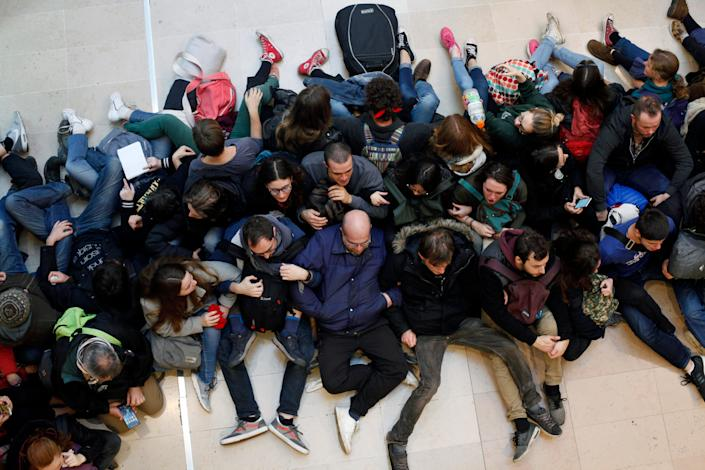 Activists block a shopping center, in the business district of Paris, La Defense, in Paris, Friday, Nov. 29, 2019. People don't celebrate Thanksgiving in France, or Denmark, or the Czech Republic, but they do shop on Black Friday. The U.S. sales phenomenon has spread to retailers across the Atlantic in recent years.