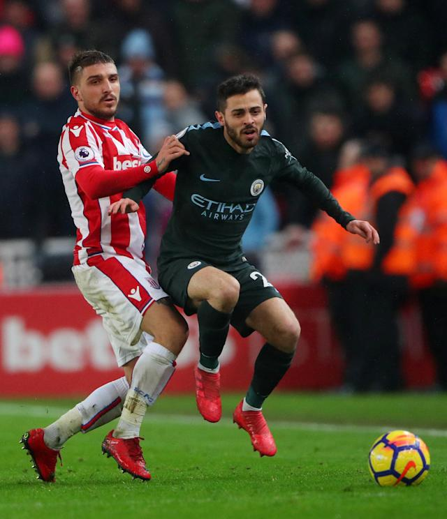 "Soccer Football - Premier League - Stoke City vs Manchester City - bet365 Stadium, Stoke-on-Trent, Britain - March 12, 2018 Stoke City's Kostas Stafylidis in action with Manchester City's Bernardo Silva REUTERS/Hannah McKay EDITORIAL USE ONLY. No use with unauthorized audio, video, data, fixture lists, club/league logos or ""live"" services. Online in-match use limited to 75 images, no video emulation. No use in betting, games or single club/league/player publications. Please contact your account representative for further details."