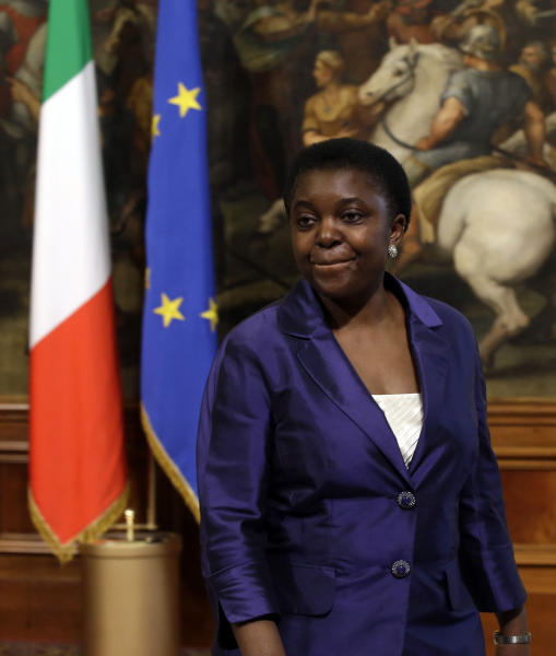 FILE - In this April 28, 2013 file photo Italian Integration Minister Cecile Kyenge arrives at Chigi palace Premier's office, in Rome. The appointment of Italy's first black cabinet minister was initially hailed as a giant step forward for a country that has long been ill at ease with its increasing immigrant classes. Cecile Kyenge's new job has instead exposed Italy's ugly race problem, an issue that flares regularly on the football pitch with racist taunts and in the rhetoric of xenophobic political parties but has come to the fore anew as a shaky coalition government tries to bring Italy out of its economic doldrums. Kyenge, 48, was born in Congo and moved to Italy three decades ago to study medicine. An eye surgeon, she lives in Modena with her Italian husband and two children and was active in local center-left politics before winning a seat in the lower Chamber of Deputies in February elections. (AP Photo/Gregorio Borgia, File)