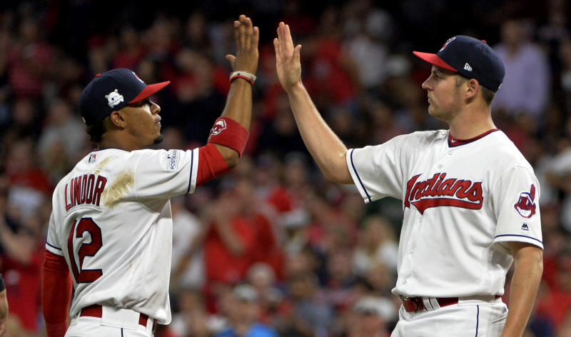 Trevor Bauer, right, gets congratulated by Francisco Lindor after his start in ALDS Game 1 against the Yankees. (AP)
