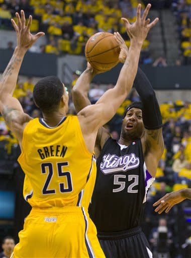 Sacramento Kings' James Johnson works against Indiana Pacers' Gerald Green during an NBA basketball game in Indianapolis on Saturday, Nov. 3, 2012. (AP Photo/Doug McSchooler)