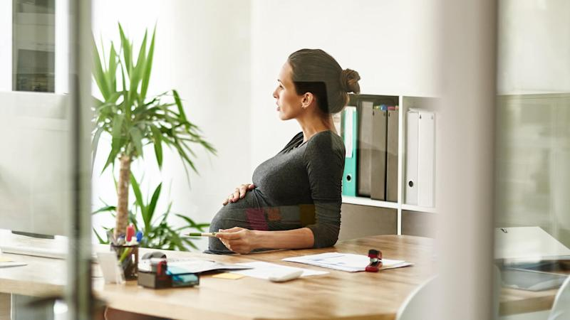 pregnant businesswoman sitting in her office