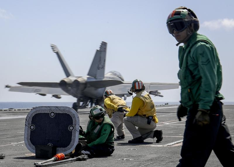 "In this Monday, May 20, 2019 photo, released by U.S. Navy, an F/A-18E Super Hornet from the ""Jolly Rogers"" of Strike Fighter Squadron (VFA) 103 launches from the flight deck of the Nimitz-class aircraft carrier USS Abraham Lincoln (CVN 72) on Arabian Sea. (Mass Communication Specialist 3rd Class Jeff Sherman/U.S. Navy via AP)"