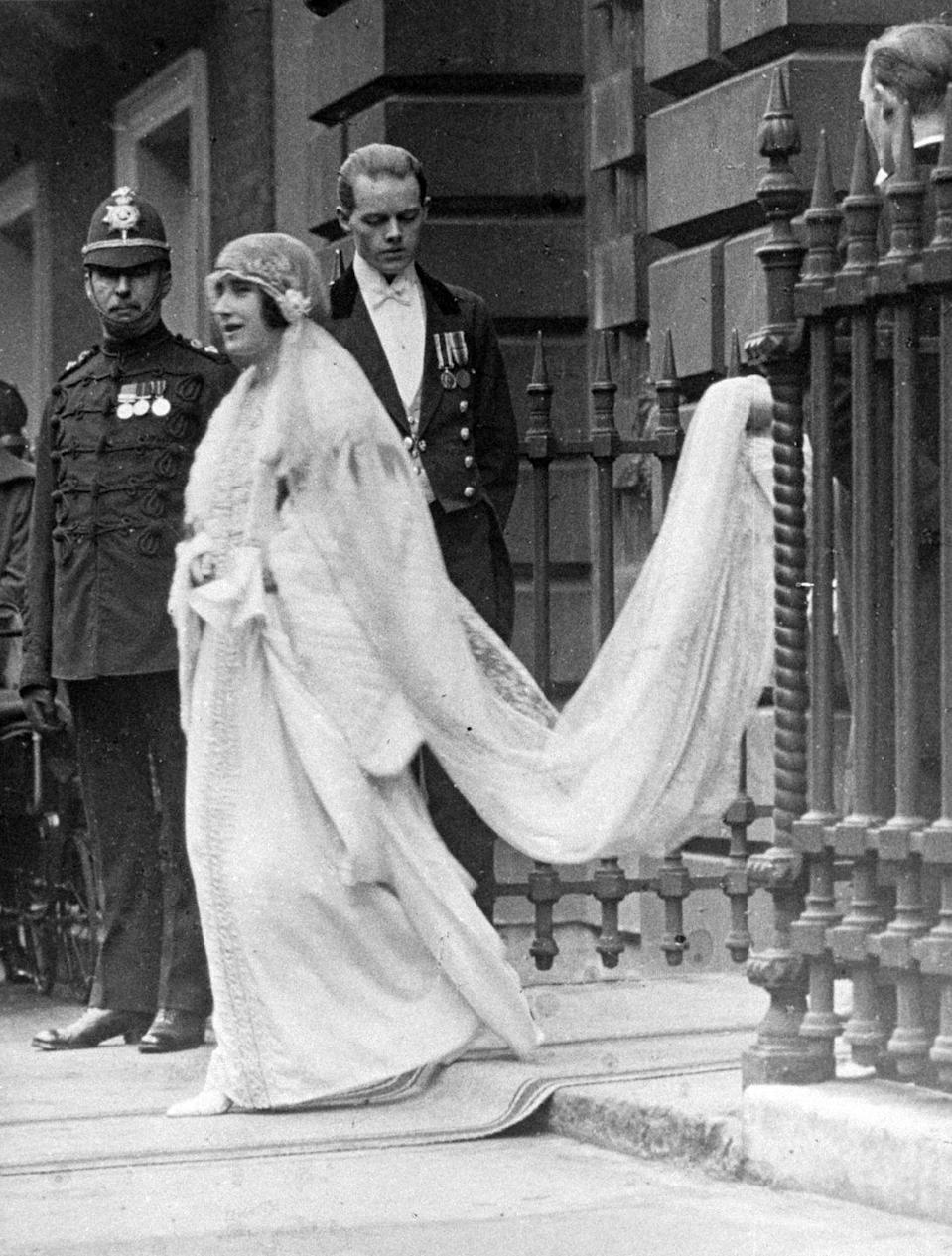 """<p>The future mother of the Queen wore a straight silhouette for her wedding to <span class=""""redactor-unlink"""">George VI</span>.</p>"""