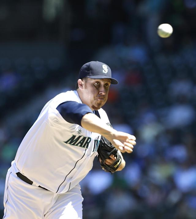 Seattle Mariners starting pitcher Aaron Harang throws against the Minnesota Twins in the second inning of a baseball game, Saturday, July 27, 2013, in Seattle. (AP Photo/Elaine Thompson)