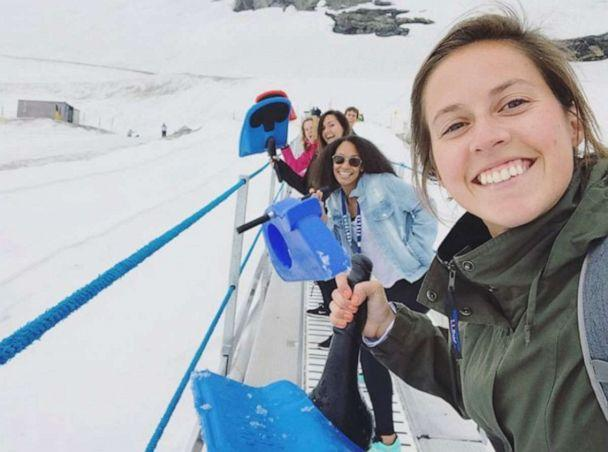 PHOTO: Taking the little electric carpet up to sled down Mt. Titlis with coworkers. (Lexie Carter )