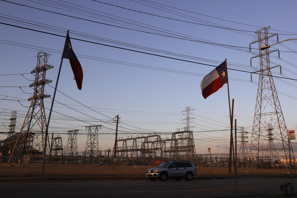 Texas flags fly near an electrical substation on February 21, 2021 in Houston, Texas. (Photo by Justin Sullivan/Getty Images)