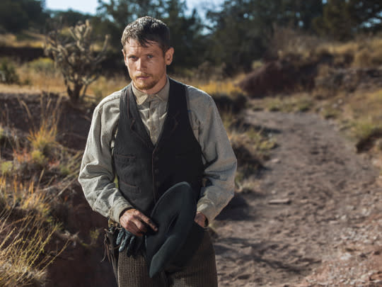 <p>That man is Roy Goode, who's good with a gun and Alice's wild horses. Once presumed dead, he's returned now to steal all the spoils from his former gang's latest train robbery — hence his injuries.<br>(Photo: James Minchin/Netflix) </p>