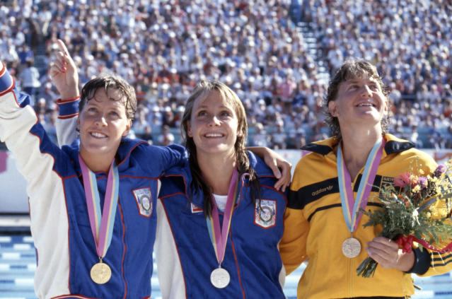 Tracy Caulkins, left, and Nancy Hogshead, middle, won gold and silver, respectively, in the women's 200-meter IM at the 1984 Summer Olympics. (Walt Disney Television via Getty Images)