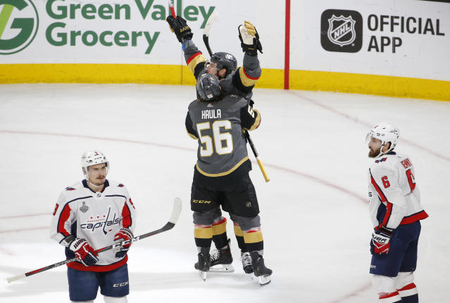 Vegas Golden Knights left wing James Neal, back center, celebrates his goal with left wing Erik Haula as Washington Capitals defensemen Dmitry Orlov, left, of Russia, and Michal Kempny, of the Czech Republic, stand nearby during the first period in Game 2 of the NHL hockey Stanley Cup Finals on Wednesday, May 30, 2018, in Las Vegas. (AP Photo/Ross D. Franklin)