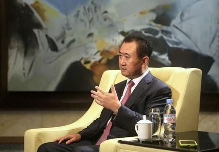 Wang Jianlin, chairman of Chinese property developer Dalian Wanda Group, answers a question in Qingdao