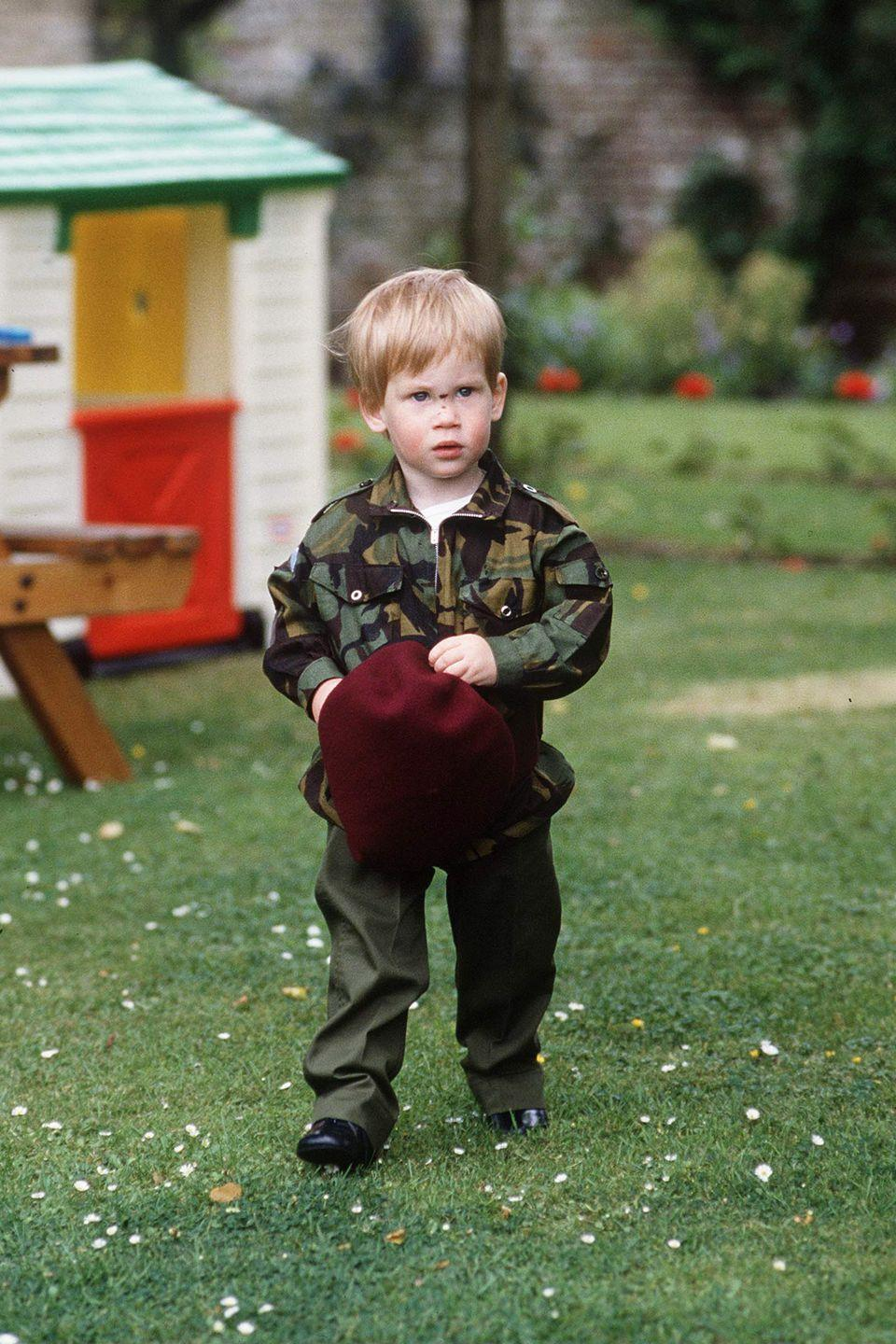 <p>The young royal plays in the backyard of Highgrove House wearing an army uniform. </p>