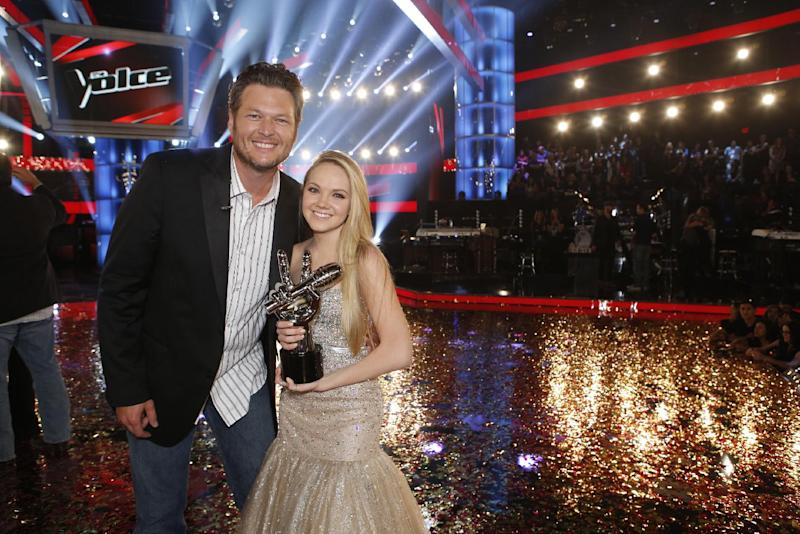 """In this image provided by NBC Blake Shelton and Danielle Bradbery pose after she won season-four of """"The Voice"""" Tuesday June 18, 2013. Bradbery never had a big singing gig or a vocal lesson. It's also the third win for her coach Blake Shelton.  (AP Photo?NBC, Trae Patton)"""