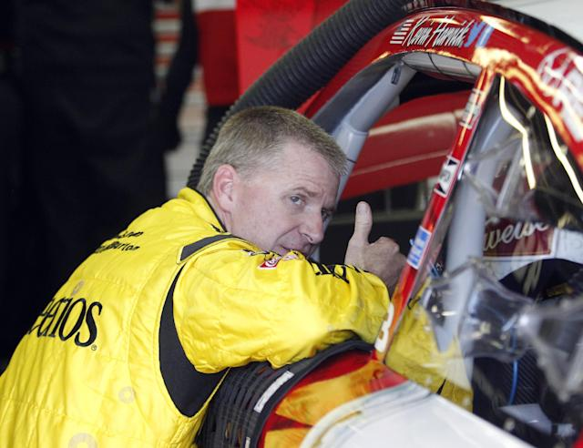 Jeff Burton leans in to talk with Kevin Harvick during practice for Sunday's NASCAR Sprint Cup Series auto race at New Hampshire Motor Speedway, Friday, Sept. 20, 2013, in Loudon, N.H. (AP Photo/Mary Schwalm)
