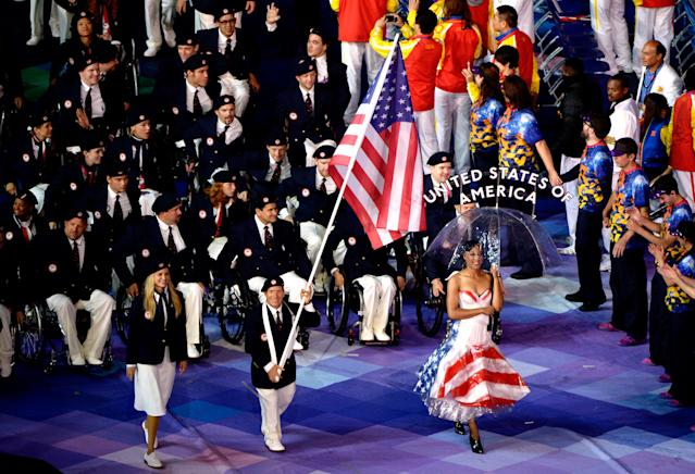 LONDON, ENGLAND - AUGUST 29: Athlete Scott Danberg of United States carries the flag during the Opening Ceremony of the London 2012 Paralympics at the Olympic Stadium on August 29, 2012 in London, England. (Photo by Dennis Grombkowski/Getty Images)