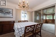 <p><span>1611 Chandler Ave., Victoria, B.C.</span><br> The formal dining room is adjacent to the living room, which has a natural gas fireplace.<br> (Photo: Zoocasa) </p>