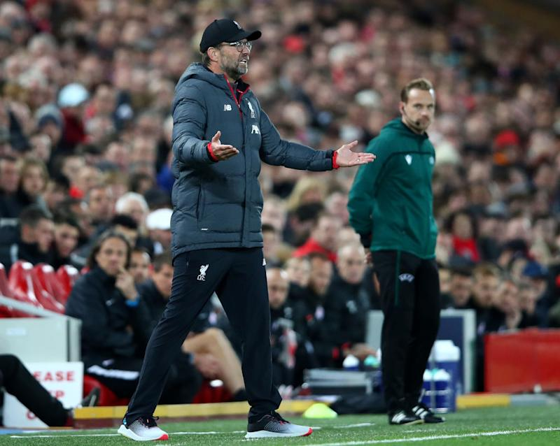 A concerned Klopp saw his side throw away a three-goal lead. (Photo by Clive Brunskill/Getty Images)