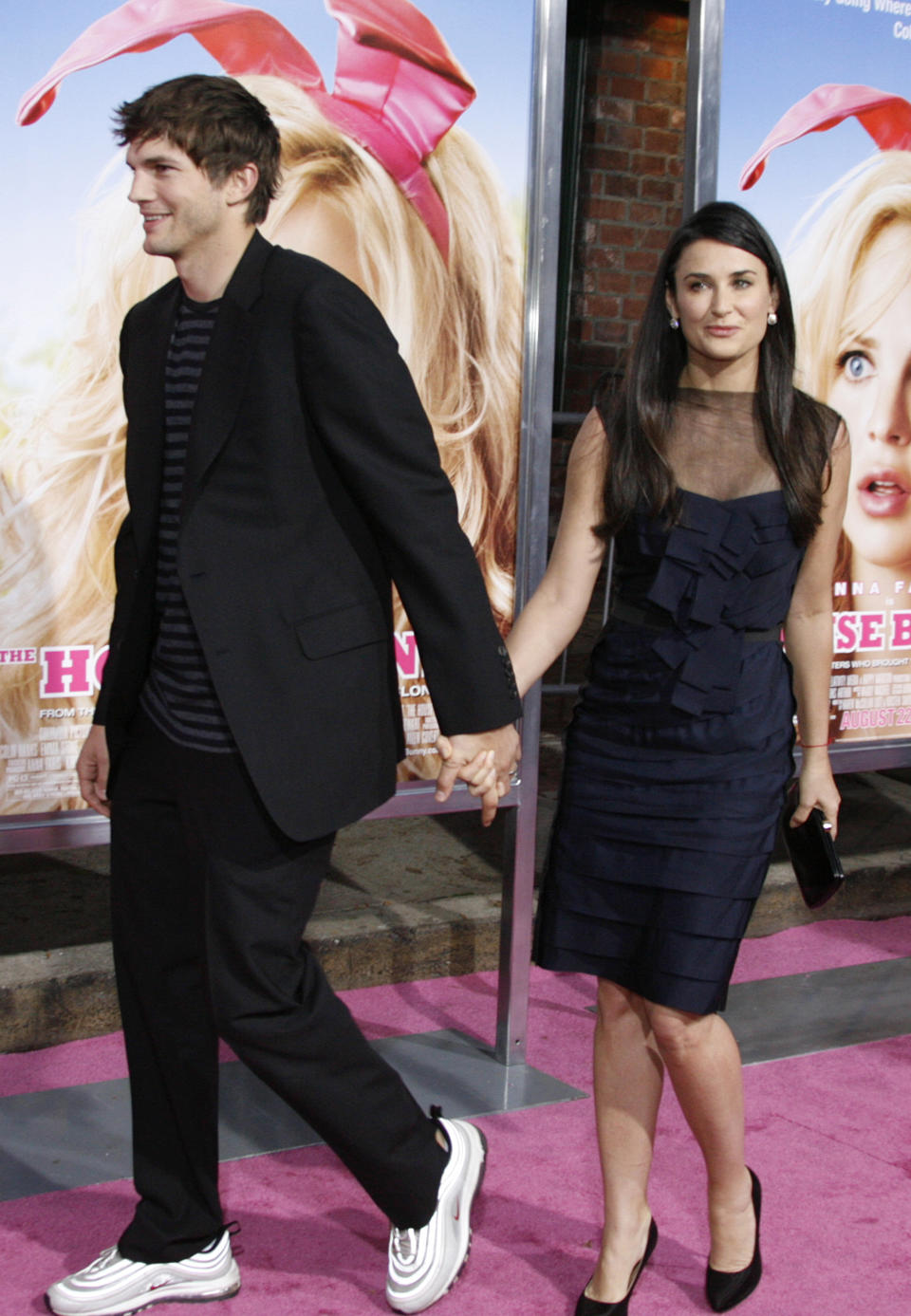 """Actress Demi Moore and her husband actor Ashton Kutcher arrive for the premiere of """"The House Bunny"""", which stars Moore's daughter Rumer Willis, in Los Angeles August 20, 2008. REUTERS/Fred Prouser (UNITED STATES)"""