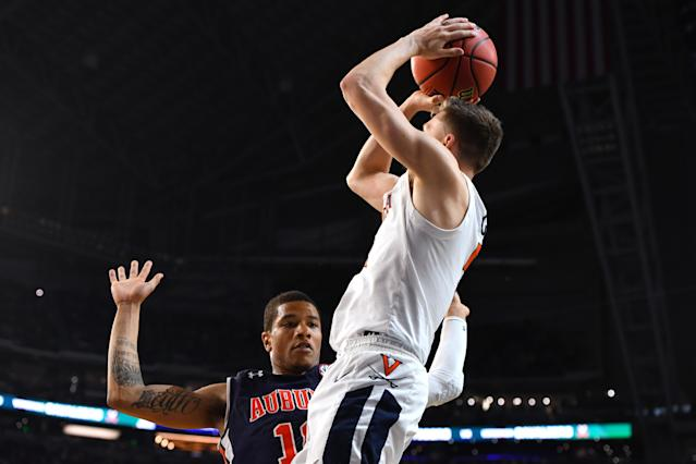 Kyle Guy #5 of the Virginia Cavaliers shoots against Samir Doughty #10 of the Auburn Tigers during the second half of the semifinal game in the NCAA Men's Final Four at U.S. Bank Stadium on April 06, 2019 in Minneapolis, Minnesota. (Photo by Jamie Schwaberow/NCAA Photos via Getty Images)