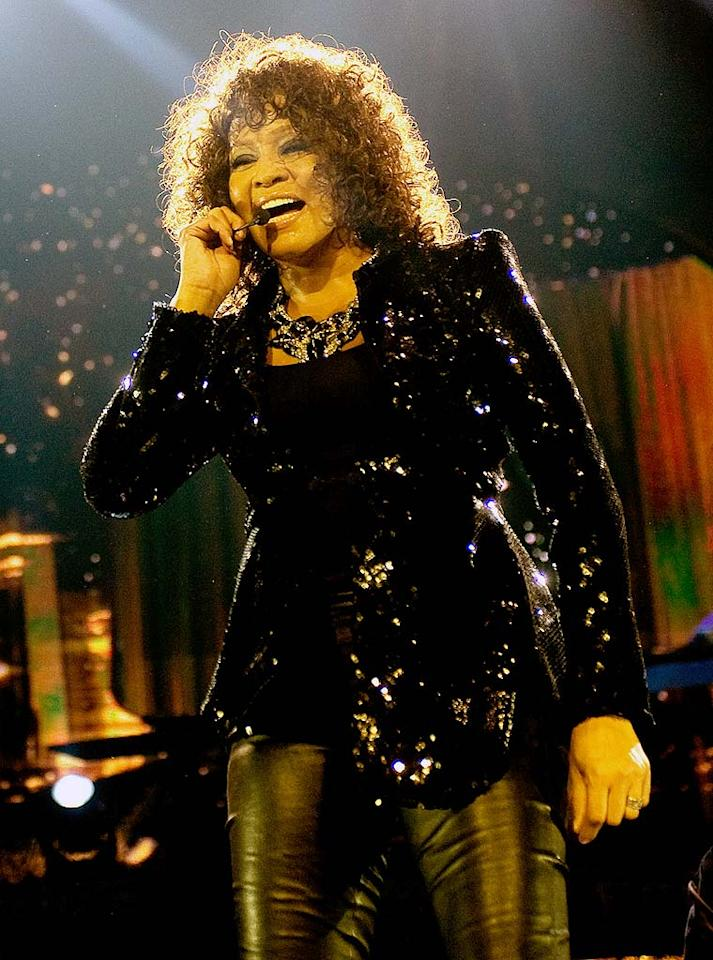 """Another singer dealing with her own dramas was Whitney Houston. Failing yet again to hit the high notes during her London concert, Houston blamed her croaky vocals on the air conditioning, telling the crowd, """"She doesn't want to come, my soprano friend. Sometimes the old girl sings, but not tonight. I want to do it, but she doesn't want to ... She's getting a little temperamental."""" Samir Hussein/<a href=""""http://www.gettyimages.com/"""" target=""""new"""">GettyImages.com</a> - April 25, 2010"""