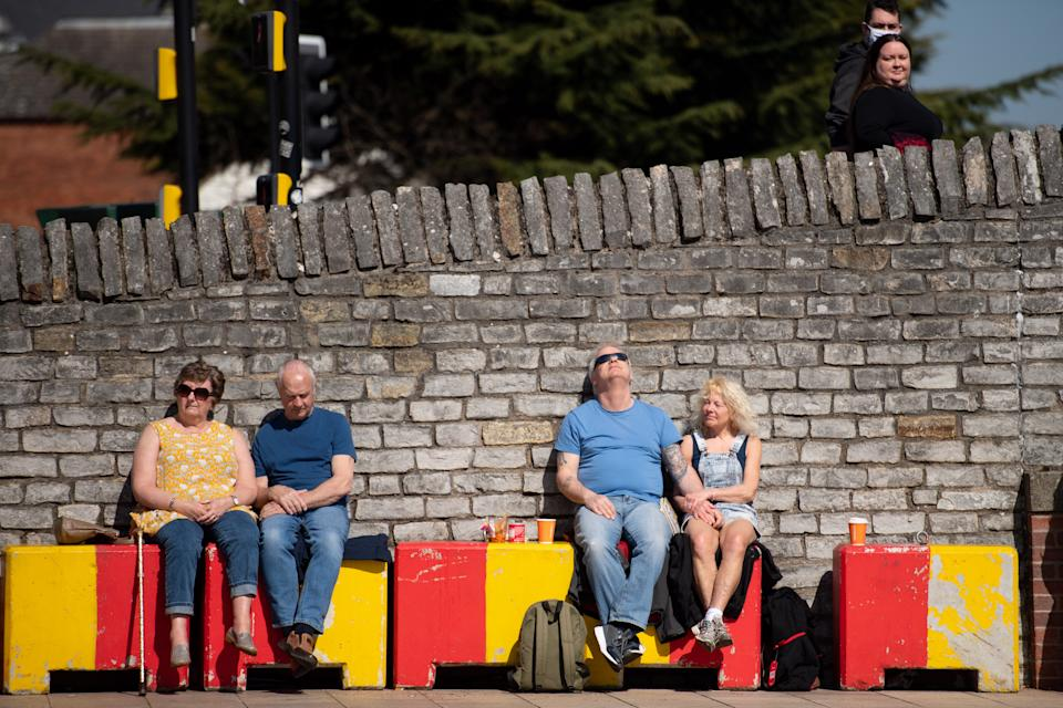 People sat enjoying the sunshine in Stratford-upon-Avon in Warwickshire. Picture date: Sunday April 4, 2021. (Photo by Jacob King/PA Images via Getty Images)