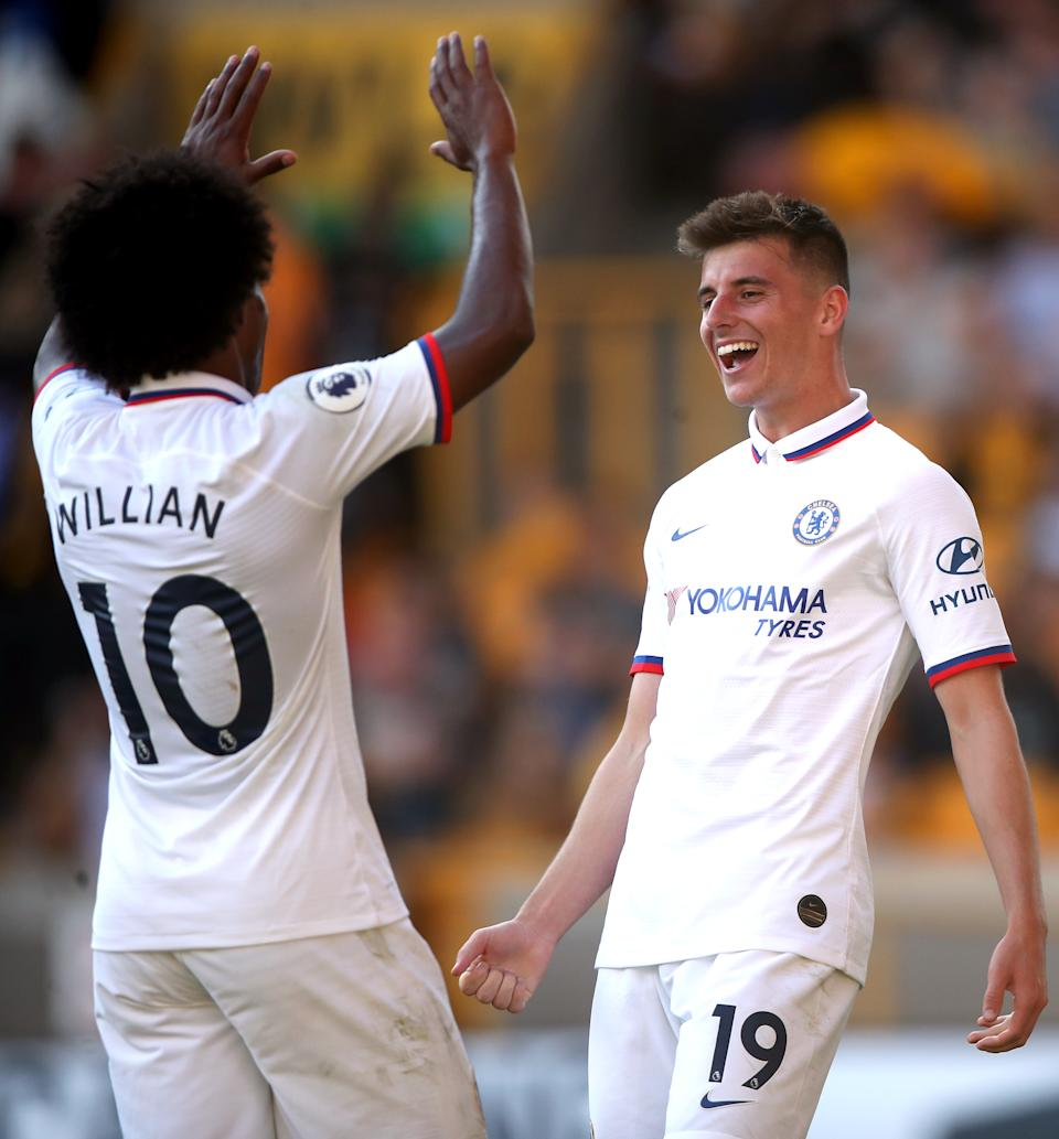 Chelsea's Mason Mount (right) celebrates scoring his side's fifth goal of the game with team-mate Willian during the Premier League match at Molineux, Wolverhampton. (Photo by Nick Potts/PA Images via Getty Images)