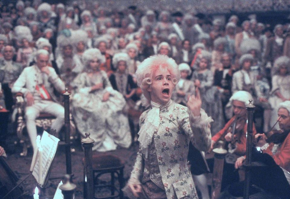 "Tom Hulce (center) stars as the enigmatic musical genius Mozart in ""Amadeus."""