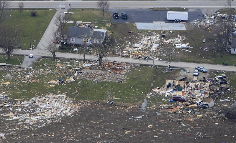 In this aerial photo, a home is shown swept away Saturday, March 3, 2012, in Holton, Indiana, after a tornado swept through the town Friday. A string of violent storms demolished small towns in Indiana and cut off rural communities in Kentucky as an early season tornado outbreak killed more than 30 people, and the death toll rose as daylight broke on Saturday's search for survivors.(AP Photo/Al Behrman)