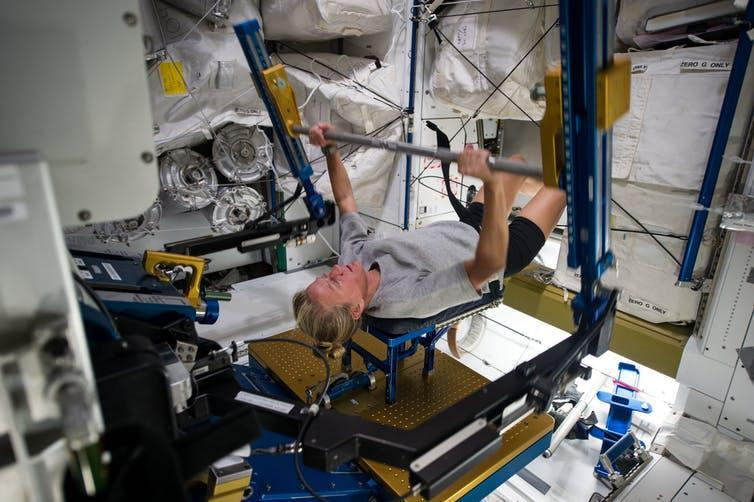 Astronaut Karen Nyberg exercises using the Advance Resistive Exercise Device to prevent bone mass loss while in space.